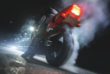 Motorbiker Is Burning A Tire Rubber On Night Road.