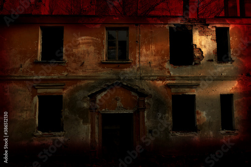Valokuvatapetti scary abandoned building with dark Windows at sunset