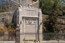 Vina Del Mar, Chile - December 8, 2008: Closeup Of Gray Stone Founding Monument With Long Text At Federico Santa María Technical University. Some Green Foliage And Gray Stone Wall.