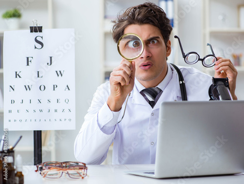Obraz Funny eye doctor in humourous medical concept - fototapety do salonu