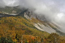 Threatening Dark Low Clouds Enveloping Rocky Summit Of Cannon Mountain In New Hampshire's Franconia Notch Sate Park.