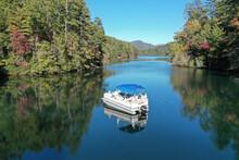Aerial View Of Pontoon Boat On Lake Santeetlah, North Carolina In Autumn.
