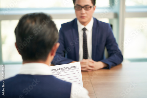 Obraz asian corporate hr manager interviewing job candidate - fototapety do salonu