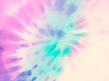 Swirl Tie Dye Background. Hippie Spiral Tie-dye Wallpaper Backdrop. Tiedye In Pastel Pink And Cyan.