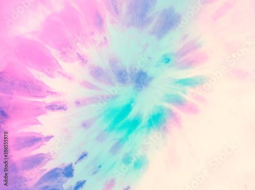 Swirl tie dye background. Hippie spiral tie-dye wallpaper backdrop. Tiedye in pastel pink and cyan.