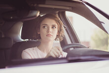 Photo Of Charming Pretty Lady Calm Concentrated Face Hands Hold Steering Wheel Drive Car Carefully Watch Rearview Mirror Wait Another Driver Make Turn Wear White Shirt Indoors