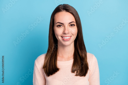 Portrait of lovely nice girl look in camera toothy smiling wear beige pullover isolated over blue color background