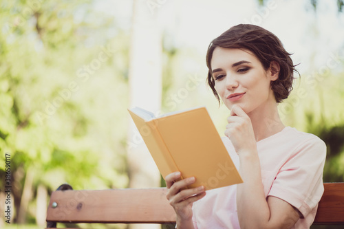 Obraz Photo sweet adorable interested lady sit bench read yellow book intriguing love adventure hero story peaceful lifestyle concept new knowledge exam preparation wear pink t-shirt park outdoors - fototapety do salonu