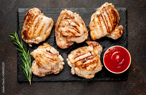 Cuadros en Lienzo grilled chicken thighs without skin on a stone background