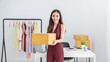 Startup small business entrepreneur SME, asian woman packing box. Portrait of young Asian small business owner in home office, online sell marketing delivery, SME e-commerce telemarketing concept