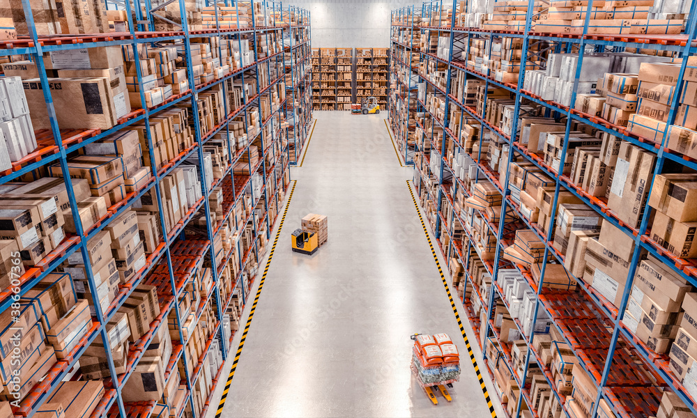 Fototapeta interior of a large warehouse with very high shelves