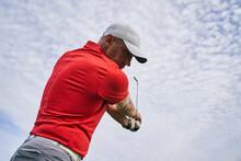 Professional Male Athlete Improving His Golf Upswing