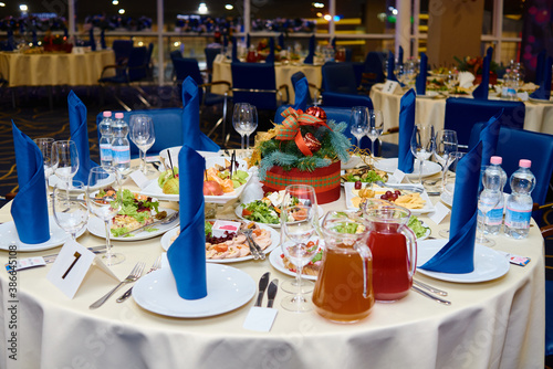 Obraz na plátně KHARKIV, UA - DECEMBER 28, 2018: Table setting with white plates , blue serviettes and cutlery on table, copy space