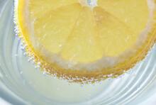 Lemon Slice Floating On Water ...