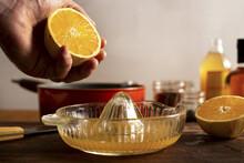 Juicing An Orange For A Mulled Apple Cider And Orange Cocktail.