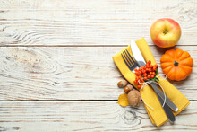 Top View Of Cutlery With Napkin And Autumn Items On White Wooden Table, Space For Text. Thanksgiving Day
