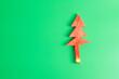 Leinwandbild Motiv Christmas tree of watermelon on green background. Merry Xmas and happy New Year party, Celebrating and dessert concept