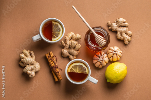 Natural cold and flu home remedies: hot tea cups with lemon, honey, ginger and garlic to boost immune system Wallpaper Mural