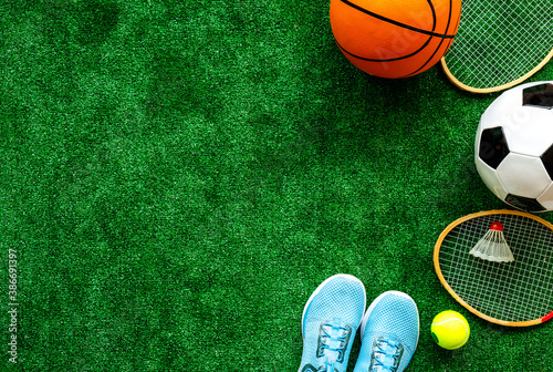 Obrazy Sporty z Piłkami  frame-of-sport-balls-football-basketball-on-grass-top-view-copy-space