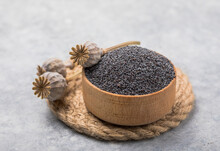 Poppy Seeds In Small Bowl With...