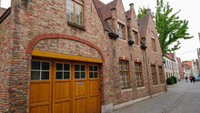 Bruges, Belgium - May 12, 2018:  Roofs And Windows Of Old Authentic Brick Houses On Street Ontvangers-straat