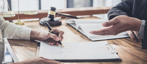 Fotografering Male lawyer or judge consult having team meeting with Businesswoman client, Law