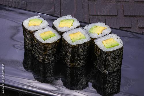 Fototapeta Japanese roll maki with avocado obraz
