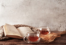 Beautiful Rustic Template Of Two Cups Of Tea And Book On Wooden Background. Cozy Natural Autumn Background. Autumn Concept. Flat Lay Style. Vintage Card With Fall Background For Concept Design.