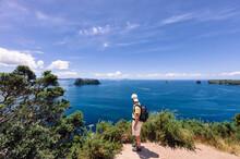Hiker Overlooking Coastline In...