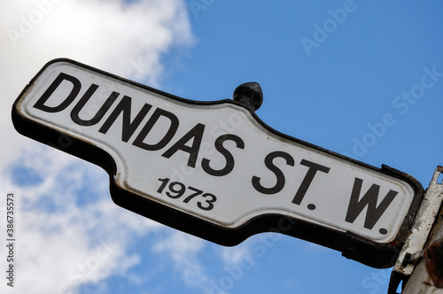 Naklejka premium Toronto, Ontario, Canada - Oct. 11, 2009: Street sign of Dundas Street, currently under petition to be renamed due to its association with anti abolitionist Henry Dundas.