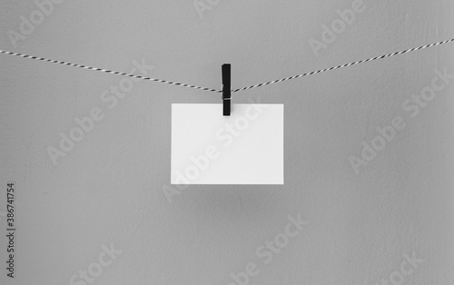 white paper on a clothesline - 386741754