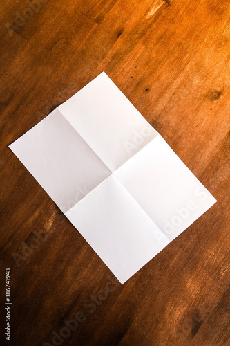 blank folded paper on table