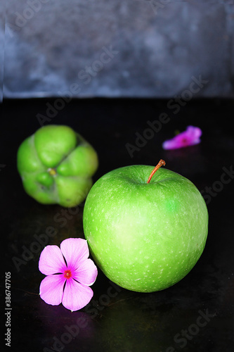 green apple with flower