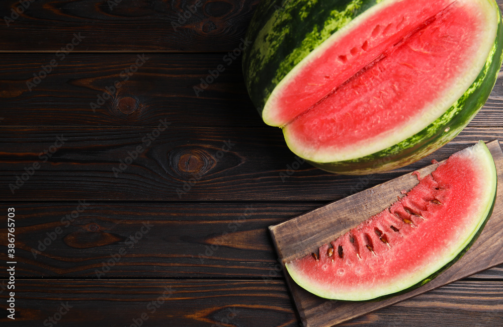 Fototapeta Yummy watermelon on wooden table, flat lay. Space for text