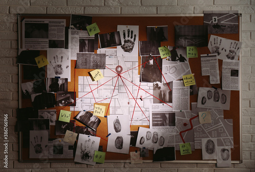 Fotografia, Obraz Detective board with fingerprints, photos, map and clues connected by red string