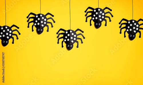 Fotografie, Obraz Halloween paper craft black spiders - flat lay
