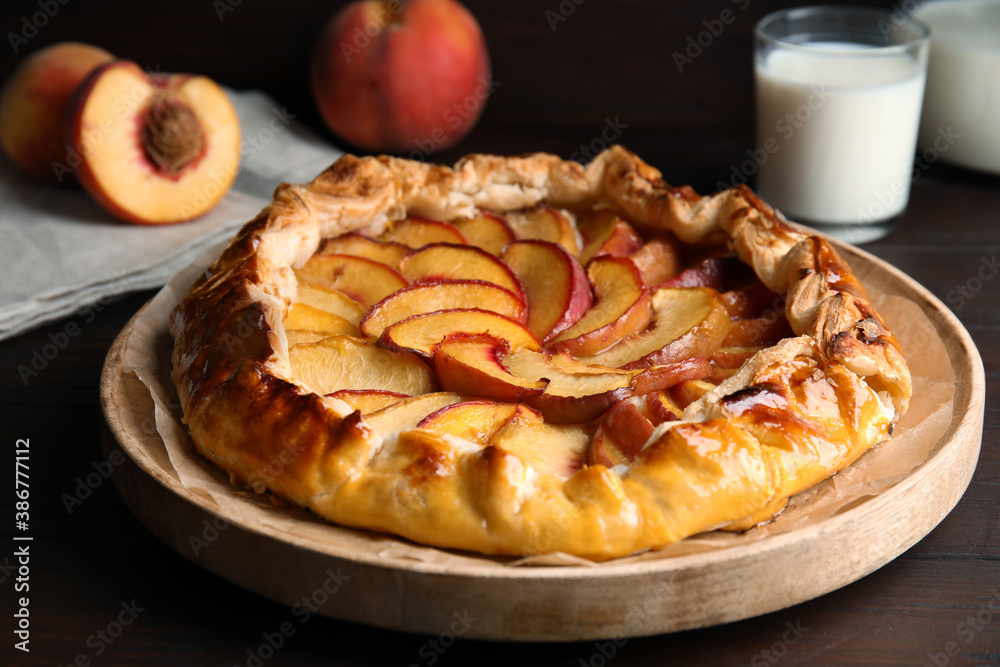 Fototapeta Delicious peach pie and fresh fruits on wooden table, closeup