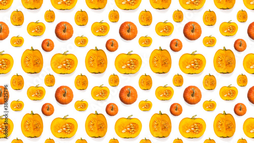 Seamless pattern of pieces and whole pumpkins isolated on a white background Canvas Print