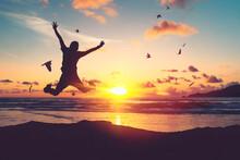 Happy Man Jumping At Tropical ...