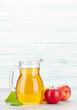 Leinwandbild Motiv Apple juice and red apple fruits