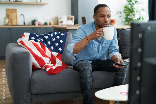 Black man affectionate in watching TV Canvas Print