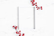 Leinwandbild Motiv Christmas composition. Red berries, photo frame on marble background. Christmas, winter, new year concept. Flat lay, top view