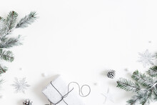 Christmas Composition. Gift Box, Fir Tree Branches, Decorations On White Background. Christmas, Winter, New Year Concept. Flat Lay, Top View, Copy Space