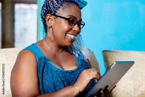 beautiful adult woman handles a digital tablet Fotobehang
