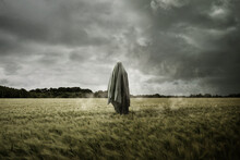 Haunted And Bleak Landscape With A Floating Spirit Ghost, Disturbing Concept.