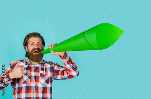 Valokuvatapetti Man shouts into a loudspeaker