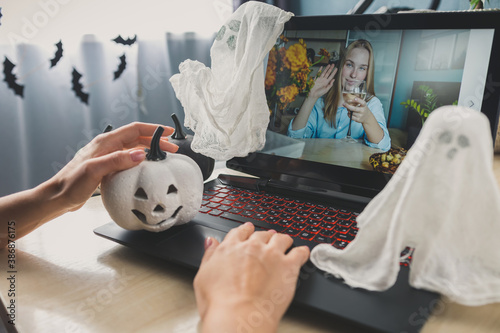 Obraz Halloween online holiday remote celebration halloween in lockdown coronavirus quarantine covid 19 new normal, social distance, remote communication, stay home vocation - fototapety do salonu