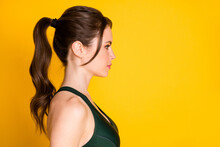 Close-up Profile Side View Portrait Of Attractive Sportive Content Healthy Girl Isolated Over Bright Yellow Color Background
