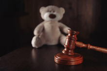 Divorce And Separation Concept. Wooden Gavel And Teddy Bear As A Symbol Children's Protection.