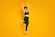 Full Size Photo Of Sportive Lady Jump High Up Active Person Raise Arms Wear Sports Suit Sneakers Isolated Yellow Color Background
